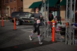 Christine running the Columbus, GA Half Marathon in Jan 2013.